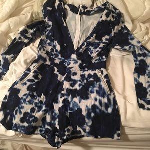 Blue patterned long sleeve romper